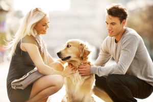 Beautiful couple with the dog.